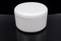 Cream container Stock Photo