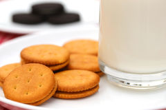 Cream cookies with glass of milk Royalty Free Stock Images