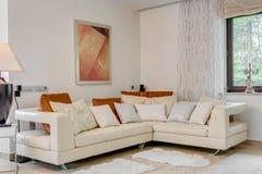 Cream corner sofa. In luxury living room Royalty Free Stock Photo