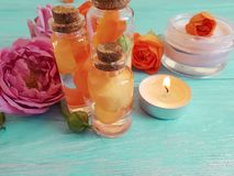 Cream cosmetic fresh rose freshness spa beautiful natural orange table candle fire on a blue wooden background, extract. Cream cosmetic fresh rose orange a blue royalty free stock photo