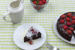 Cream covered slice of chocolate fudge cake Royalty Free Stock Photos