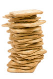 Cream Cracker stack on white. Cream Crackers balanced in a stack on white background Royalty Free Stock Images