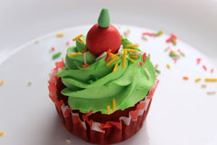 CREAM CUP CAKE. Muffin with cream green cream and brownie Stock Image