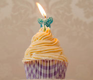 Cream cupcake with candle stock photography