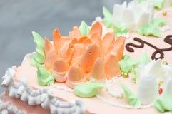 Cream decoration on cake. Flourish multi-colored cream decoration on cake Royalty Free Stock Image
