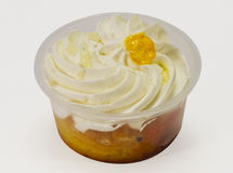 Cream Dessert. In the cup on a white background Royalty Free Stock Image