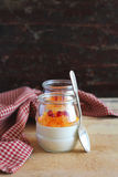 Cream dessert with persimmons and pomegranate Stock Photos