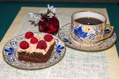 Cream dessert,raspberry, cup of coffee and vase with flower Royalty Free Stock Images