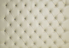 CREAM DIAMOND STUDDED PADDED LUXURY LEATHER BACKGROUND Stock Images