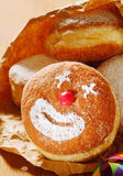 Cream doughnut with a happy clown face Stock Images