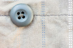 Cream fabric and button texture background Stock Images