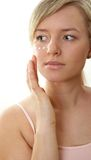 Cream on face. Beautiful woman has cream on face Stock Photo