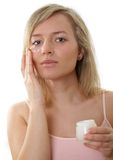 Cream on face. Beautiful woman has cream on face Stock Photos