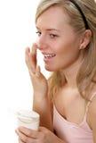Cream on face. Beautiful woman has cream on face Royalty Free Stock Photos