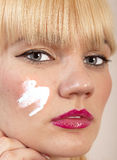 Cream on face Royalty Free Stock Photography