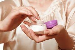 Cream in female hands