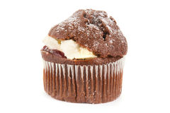 Cream filled chocolate muffin on white Stock Photography