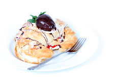 Cream filled croissant with chocolate strawberry. And fork Stock Photography