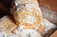 Cream filled pastries in a brown box. Royalty Free Stock Images
