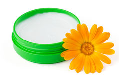 Cream with flower. On white background Stock Photo