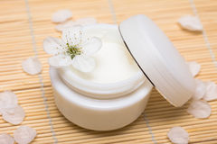 Cream with flower Stock Photography