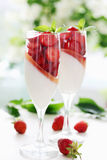 Cream gelatin with strawberries Stock Images