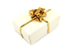 Cream Gift Box with Gold Ribbon Royalty Free Stock Photo