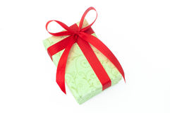 Cream gift box with red ribbon Stock Photo