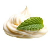 Cream with green mint leaf Royalty Free Stock Photos