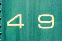 49 cream and green old metal background texture. Cream and green background texture from an old metal train car. number 49 fourty nine. four and nine 4 and 9 Stock Photos