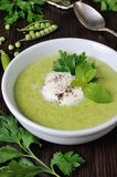 Cream of green peas with mint Royalty Free Stock Images