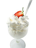 Cream half strawberry white background. Cup of cream and half strawberry white background Royalty Free Stock Image
