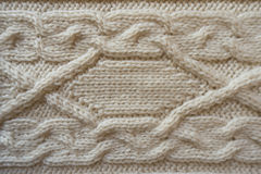 Cream handmade knitwork with horizontal plait pattern. From above Royalty Free Stock Images