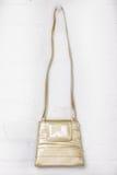 Cream Hanging Handbag. Cream handing vintage handbag against a brick wall stock photography