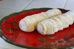 Cream Horn pastries with powdered sugar Royalty Free Stock Images
