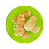 Cream horns on a green dish Royalty Free Stock Photos