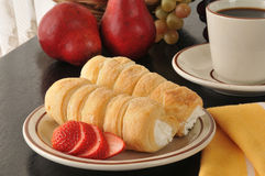 Cream horns and strawberries Stock Photography