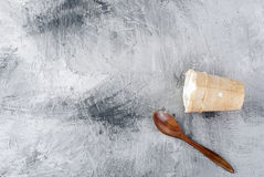 Cream ice cream in a waffle cup and a spoon. Vanilla cream ice cream in a waffle cup and a wooden spoon on a gray background. Top view. Copy space Royalty Free Stock Photos