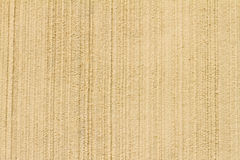 Cream Italian Stucco wall texture background. High res  cream  Stucco wall with vertical texture background from a small town in Italy Stock Photo