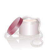 Cream jar and pearl necklace Royalty Free Stock Photography