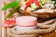 Cream jars on bamboo mat with seashells Royalty Free Stock Photo