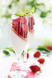 Cream jelly with strawberries Royalty Free Stock Images