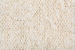 Cream knitting texture. Color cream knitting texture background Stock Image