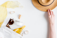 Cream and lotion cosmetic for sun protection on white background top view. Cream and lotion cosmetic for sun protection with hat in a sunbath concept on white Royalty Free Stock Photography