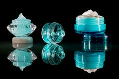 Cream lotion and gel - Cosmetics. Various creams, gels, and lotions in cosmetics containers and jars in front of a black background Stock Photography