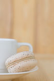Cream Macaroon , macaron with cup on wooden background. Cream Macaron , Macaroon with cup on wooden background royalty free stock photos