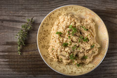 Cream made from mashed chicken breast with herbs and ground black pepper over wood. Cream made from mashed chicken breast with herbs and ground black pepper on stock images