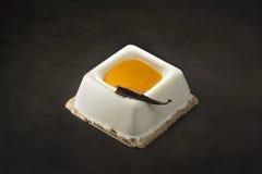 Cream and mango dessert on a black background Stock Photos