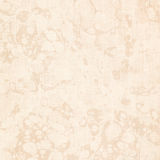 Cream marbled antique book end paper texture. Cream or beige marbled antique book end paper with linen texture - great for wedding or baby themed creations stock photo