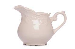 Cream milk jug. Studio cutout royalty free stock image